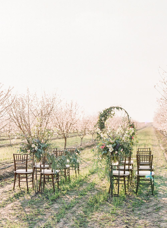 ceremony decor - photo by Katie McGihon Photography https://ruffledblog.com/spring-almond-orchard-wedding-inspiration