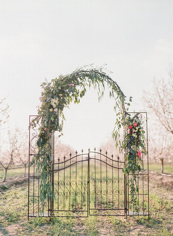 wedding ceremony decor - photo by Katie McGihon Photography https://ruffledblog.com/spring-almond-orchard-wedding-inspiration