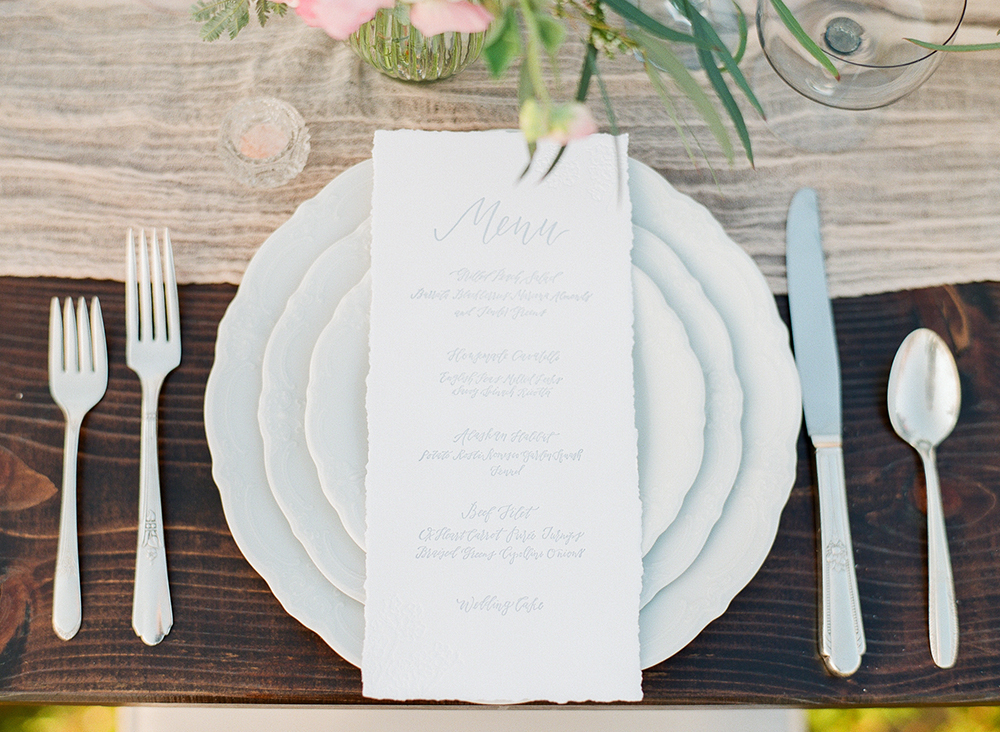 place settings - photo by Katie McGihon Photography https://ruffledblog.com/spring-almond-orchard-wedding-inspiration