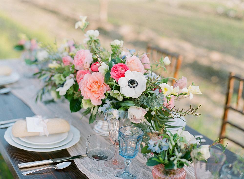 wedding centerpieces - photo by Katie McGihon Photography https://ruffledblog.com/spring-almond-orchard-wedding-inspiration