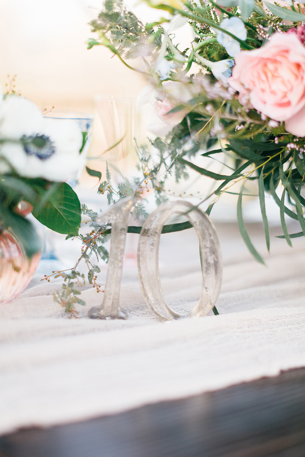 table numbers - photo by Katie McGihon Photography https://ruffledblog.com/spring-almond-orchard-wedding-inspiration
