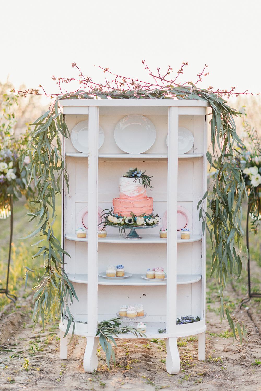 wedding cake displays - photo by Katie McGihon Photography https://ruffledblog.com/spring-almond-orchard-wedding-inspiration