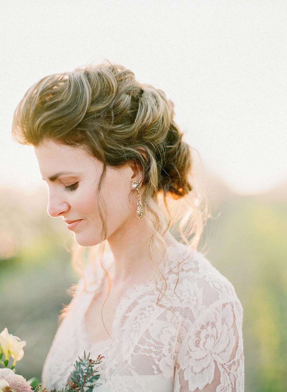bridal wedding hair - photo by Katie McGihon Photography https://ruffledblog.com/spring-almond-orchard-wedding-inspiration