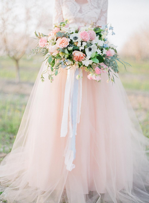 romantic bouquets - photo by Katie McGihon Photography https://ruffledblog.com/spring-almond-orchard-wedding-inspiration
