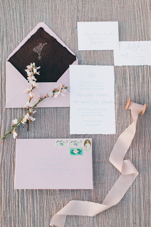pink wedding stationery - photo by Katie McGihon Photography https://ruffledblog.com/spring-almond-orchard-wedding-inspiration