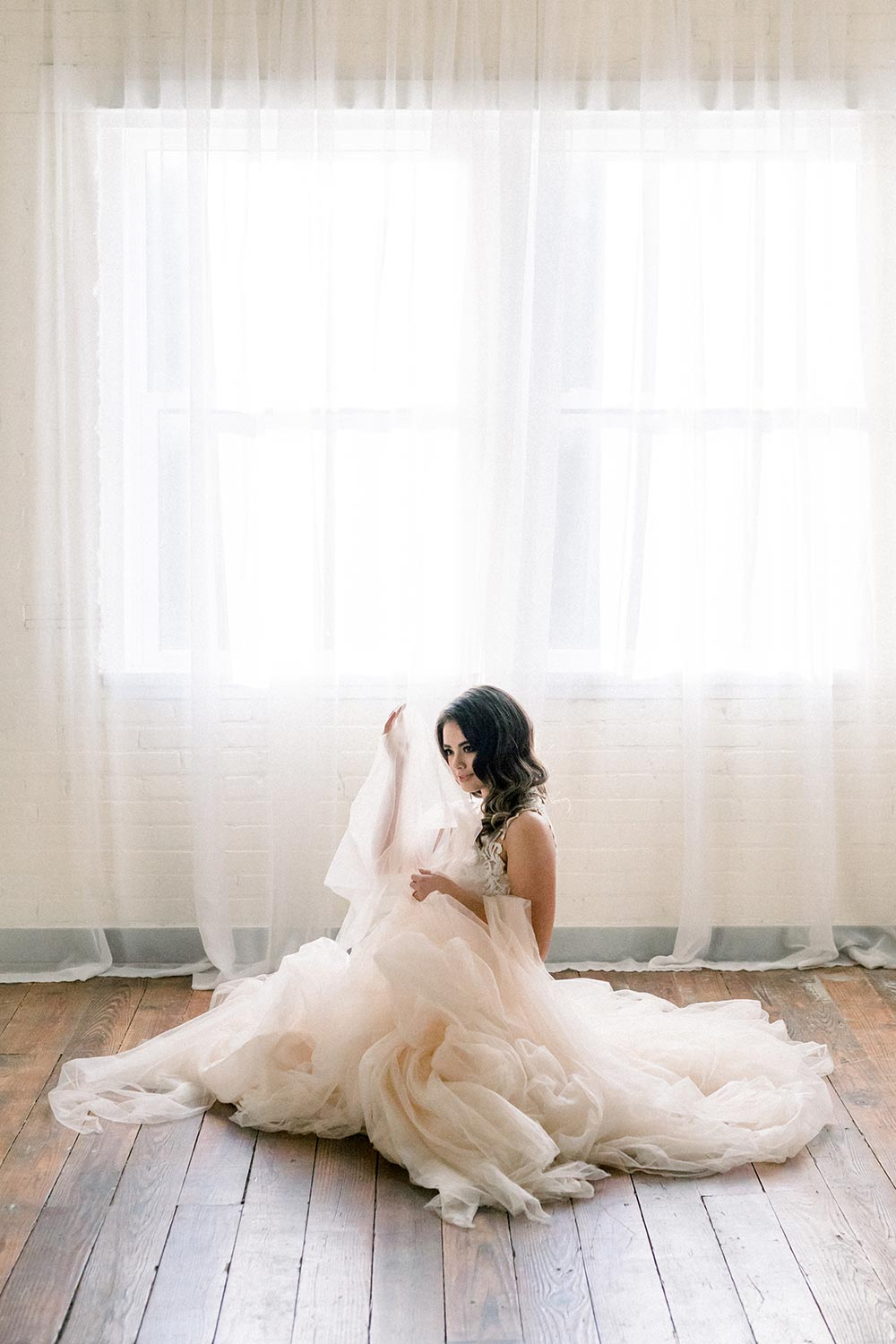backless wedding dress with intricate pattern