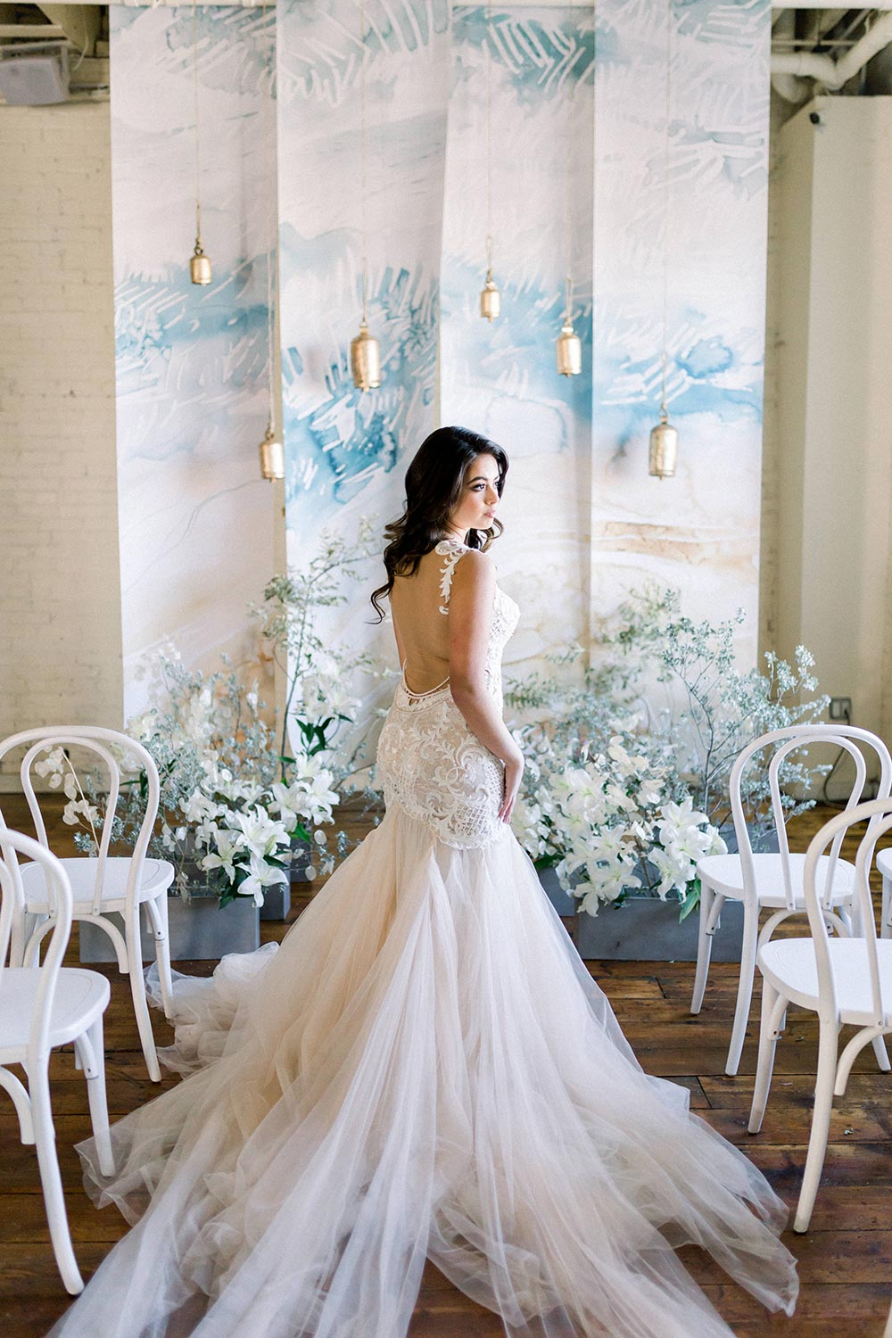 watercolor mural ceremony backdrop with wind chimes and bride in mermaid wedding dress