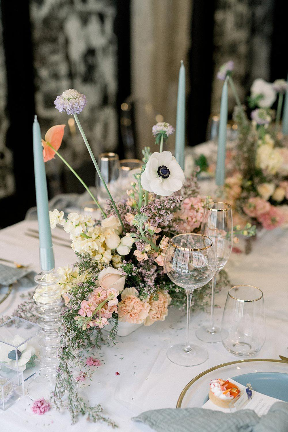 blue and peach wedding centerpiece with modern tabletop decor