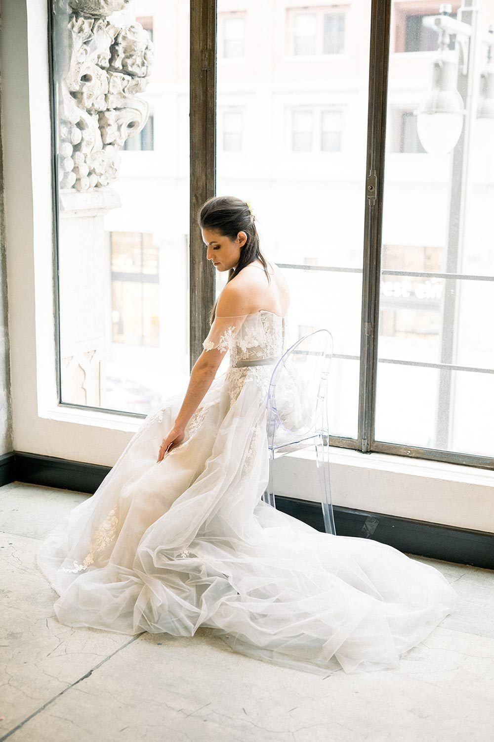 off-the-shoulder wedding dress with dusty blue tulle and lace