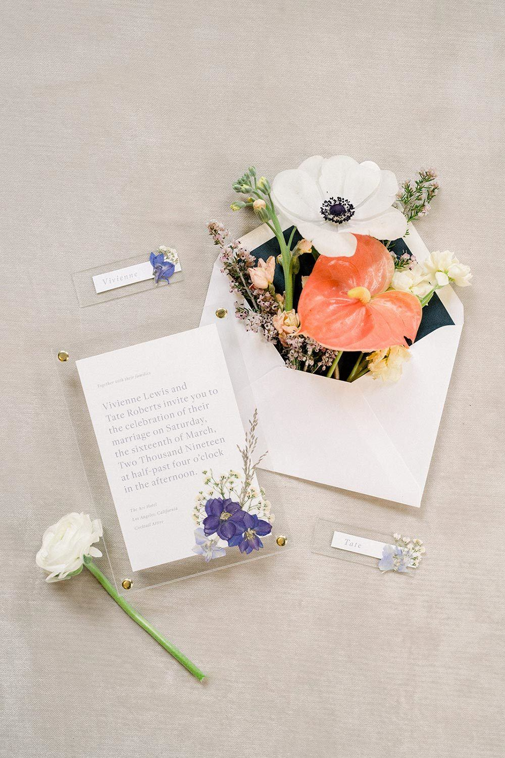 acrylic wedding invitations with pressed flowers and bold envelopes