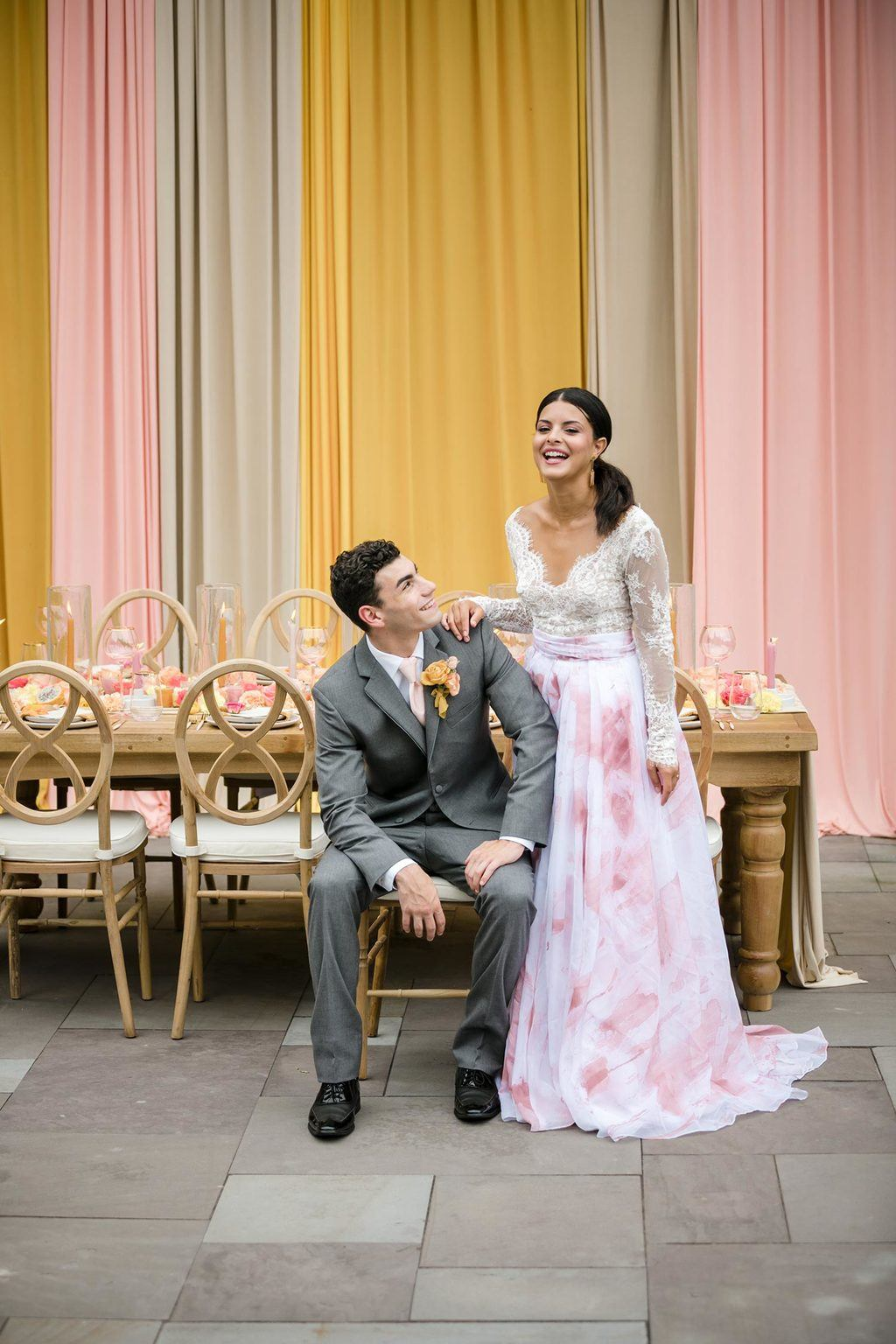 pink watercolor bridal skirt with gray groom suit