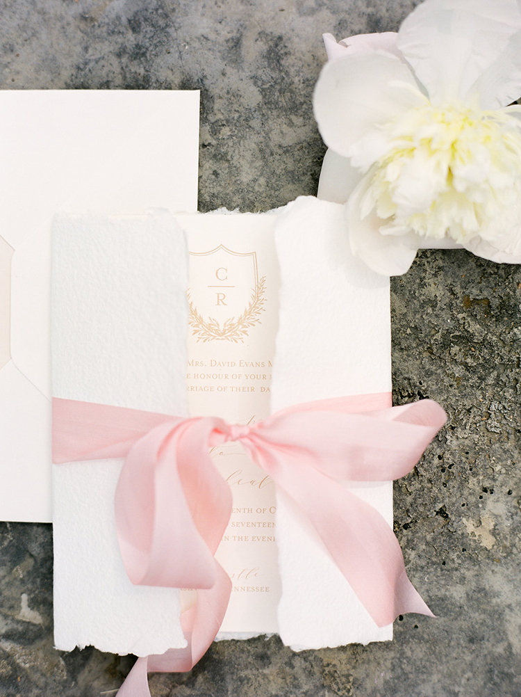 romantic torn paper wedding invitations - photo by Christy Wilson Photography https://ruffledblog.com/summer-castle-soiree-wedding-inspiration