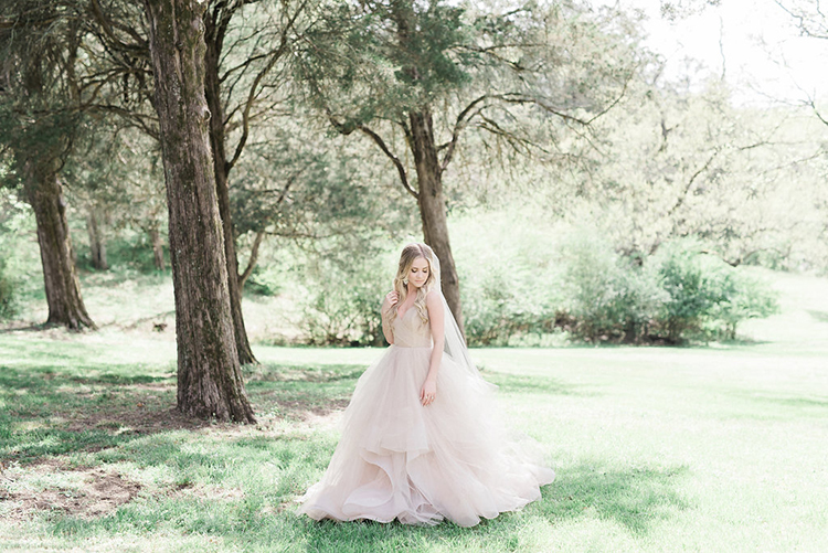 blush pink wedding dresses - photo by Christy Wilson Photography https://ruffledblog.com/summer-castle-soiree-wedding-inspiration