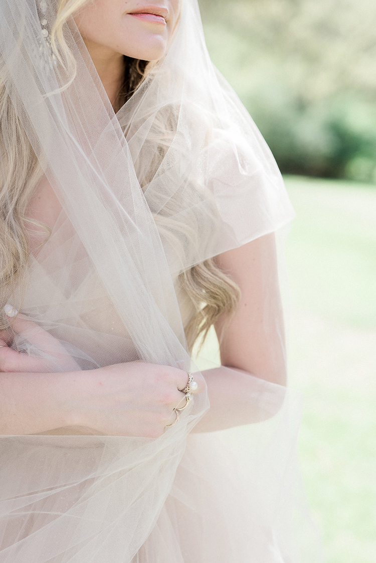 bridal veils - photo by Christy Wilson Photography https://ruffledblog.com/summer-castle-soiree-wedding-inspiration