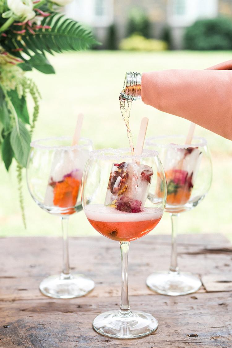 fruit popsicle cocktails - photo by Christy Wilson Photography https://ruffledblog.com/summer-castle-soiree-wedding-inspiration