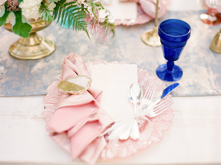 pink place settings - photo by Christy Wilson Photography https://ruffledblog.com/summer-castle-soiree-wedding-inspiration