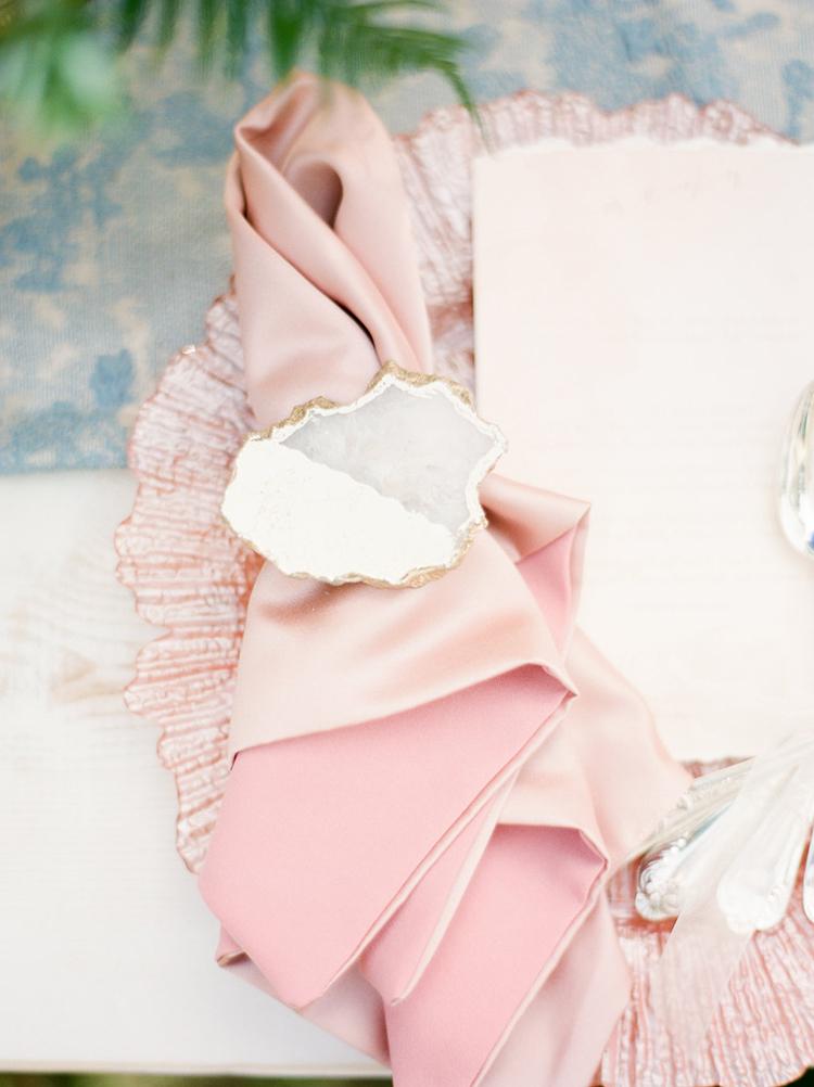 agate napkin holders - photo by Christy Wilson Photography https://ruffledblog.com/summer-castle-soiree-wedding-inspiration