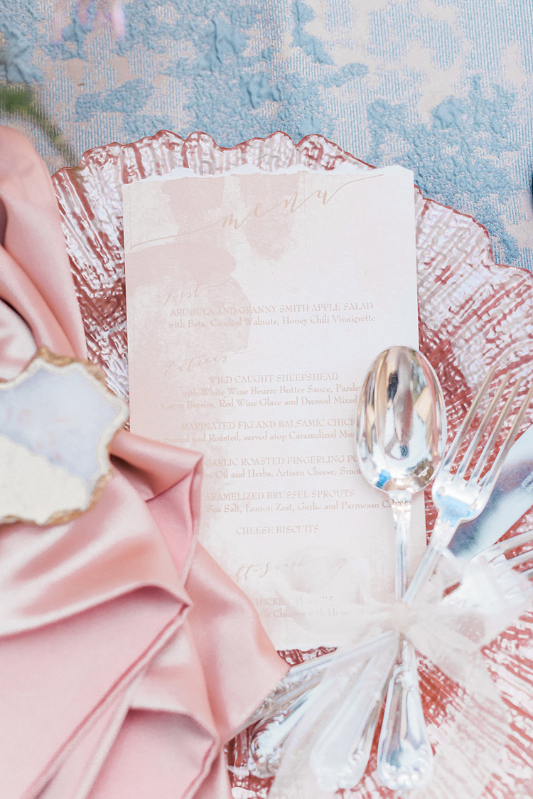 pink place settings - photo by Christy Wilson Photography http://ruffledblog.com/summer-castle-soiree-wedding-inspiration