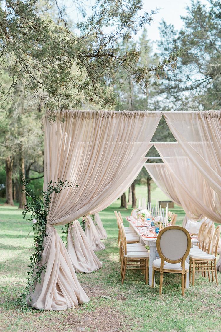 tented weddings - photo by Christy Wilson Photography https://ruffledblog.com/summer-castle-soiree-wedding-inspiration