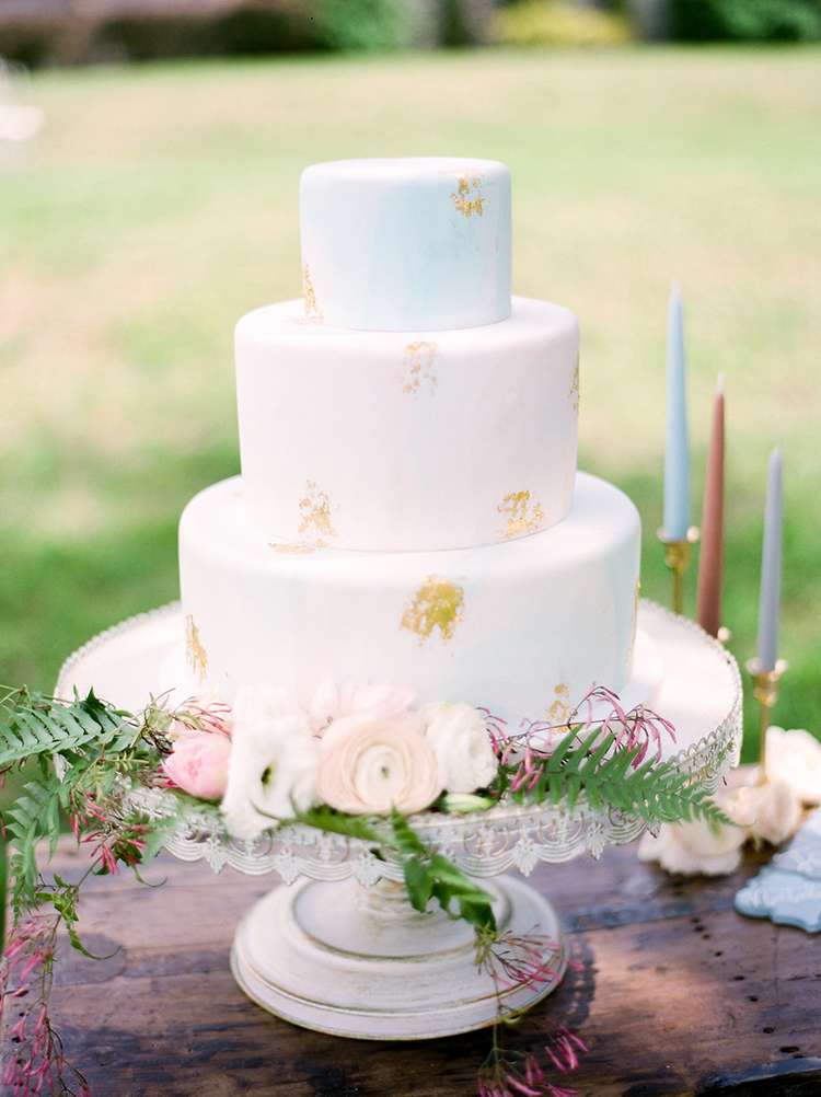 wedding cakes with gold foil - photo by Christy Wilson Photography http://ruffledblog.com/summer-castle-soiree-wedding-inspiration