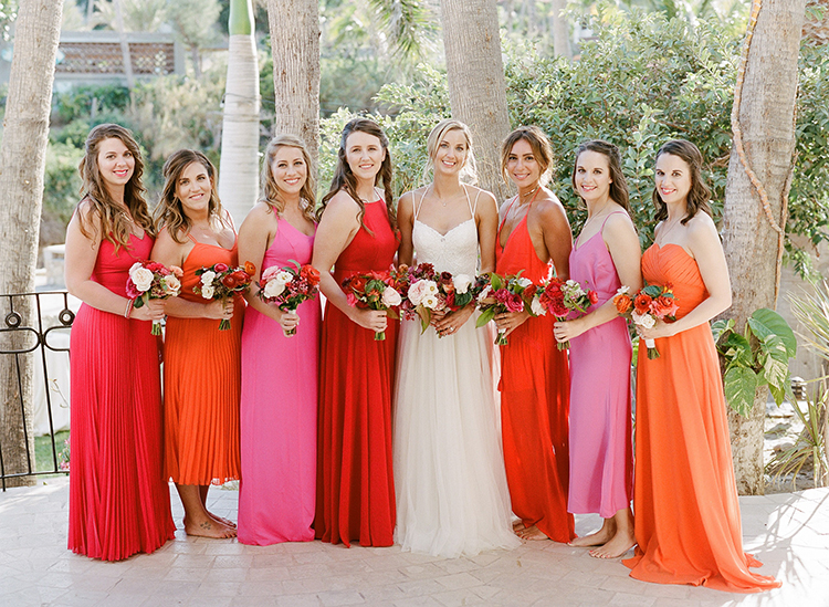 pink and orange bridesmaid dresses - photo by Ana and Jerome http://ruffledblog.com/summer-destination-wedding-in-mexico-with-bright-pinks