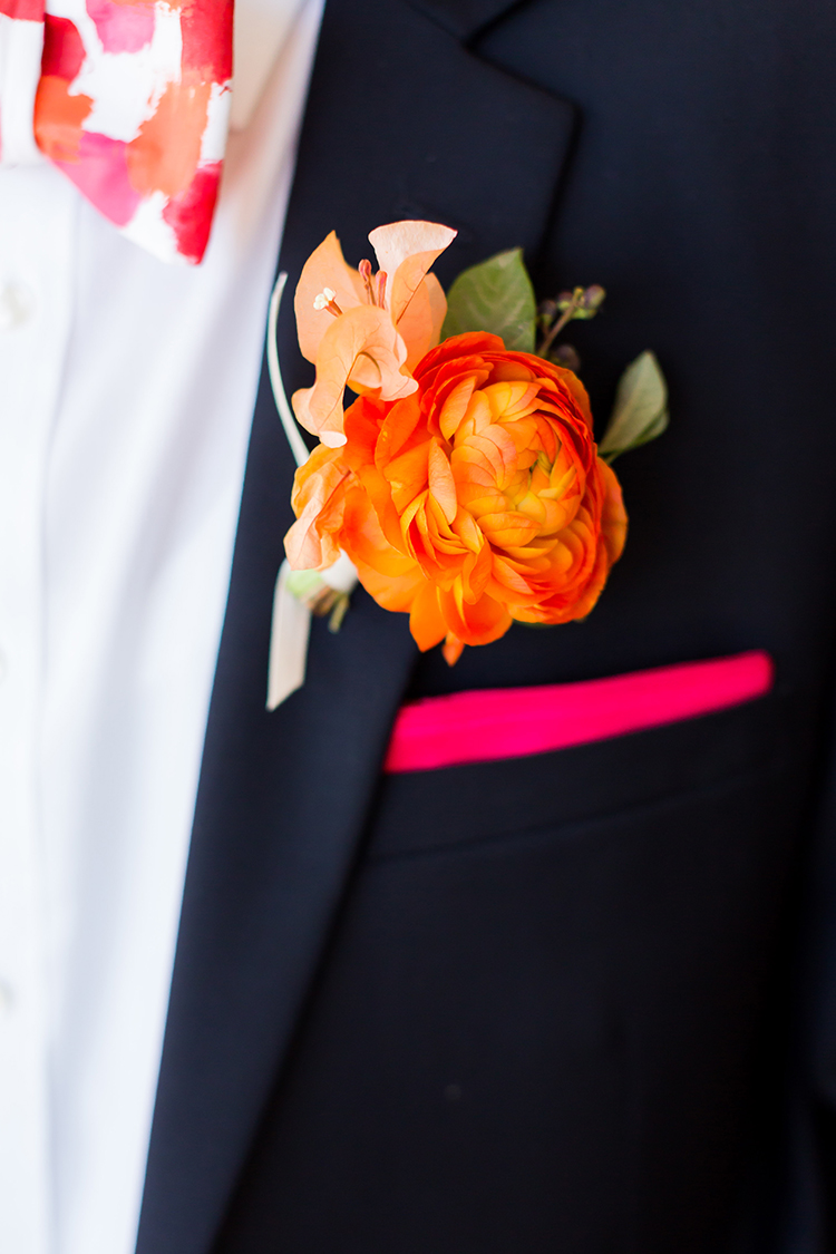 orange ranunculus boutonnieres - photo by Ana and Jerome https://ruffledblog.com/summer-destination-wedding-in-mexico-with-bright-pinks