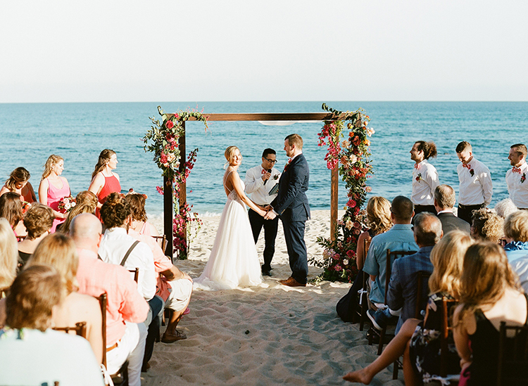beach wedding ceremonies - photo by Ana and Jerome https://ruffledblog.com/summer-destination-wedding-in-mexico-with-bright-pinks