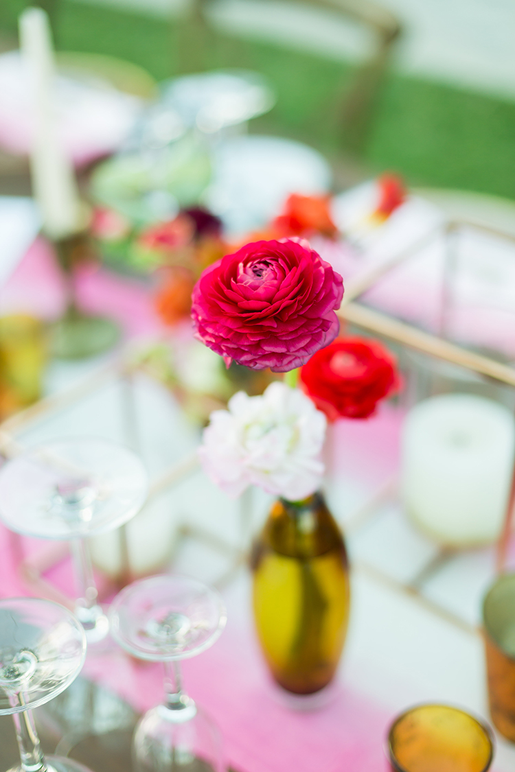 bud vase centerpieces - photo by Ana and Jerome http://ruffledblog.com/summer-destination-wedding-in-mexico-with-bright-pinks