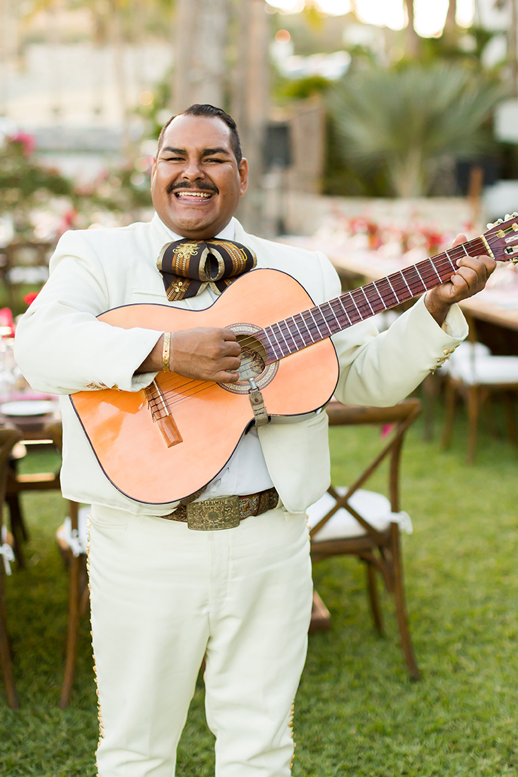 wedding music - photo by Ana and Jerome https://ruffledblog.com/summer-destination-wedding-in-mexico-with-bright-pinks