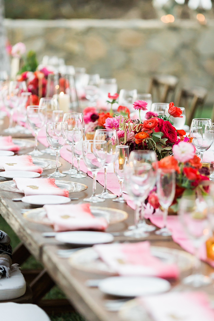 romantic family style tablescapes - photo by Ana and Jerome https://ruffledblog.com/summer-destination-wedding-in-mexico-with-bright-pinks