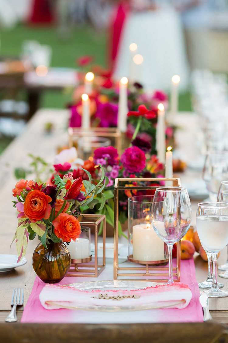 wedding table settings with pink - photo by Ana and Jerome https://ruffledblog.com/summer-destination-wedding-in-mexico-with-bright-pinks