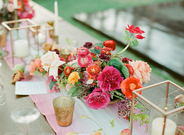 colorful pink centerpieces - photo by Ana and Jerome http://ruffledblog.com/summer-destination-wedding-in-mexico-with-bright-pinks