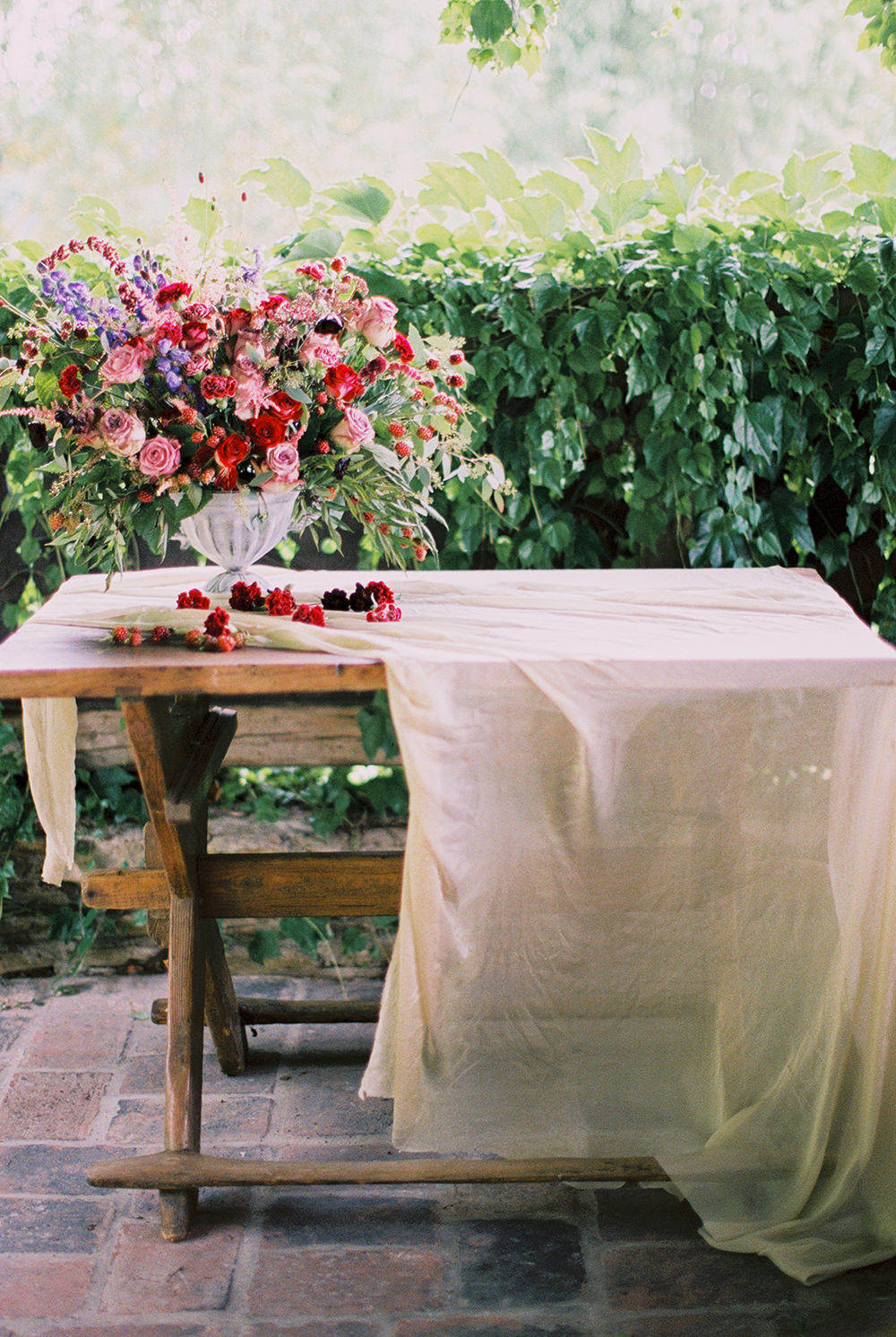 tables with flowers - photo by Warm Photo https://ruffledblog.com/summer-love-wedding-in-austria