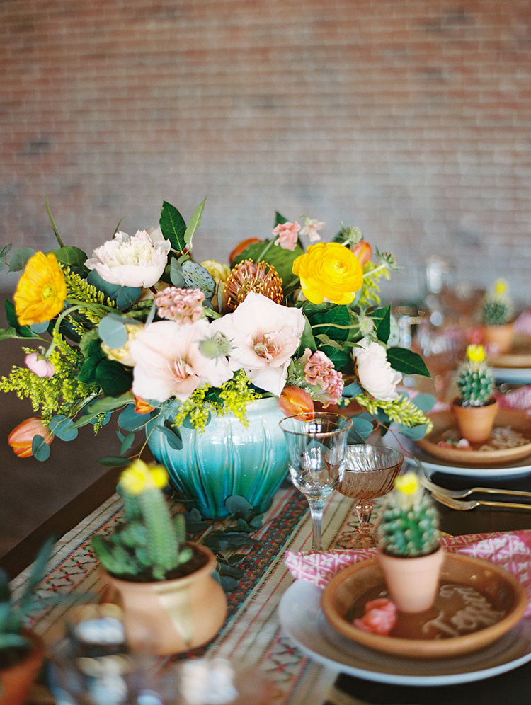 bohemian colorful centerpieces - photo by Charla Storey Photography https://ruffledblog.com/summer-loving-wedding-inspiration-with-a-fiesta-brunch