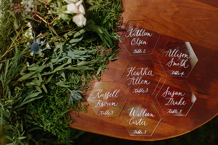acrylic seating charts - photo by Elizabeth M Photography http://ruffledblog.com/summer-meets-fall-wedding-inspiration-in-the-woods