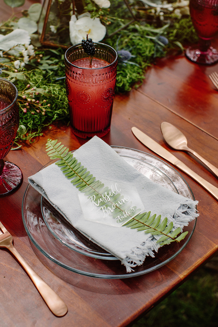 wedding decor with ferns - photo by Elizabeth M Photography http://ruffledblog.com/summer-meets-fall-wedding-inspiration-in-the-woods
