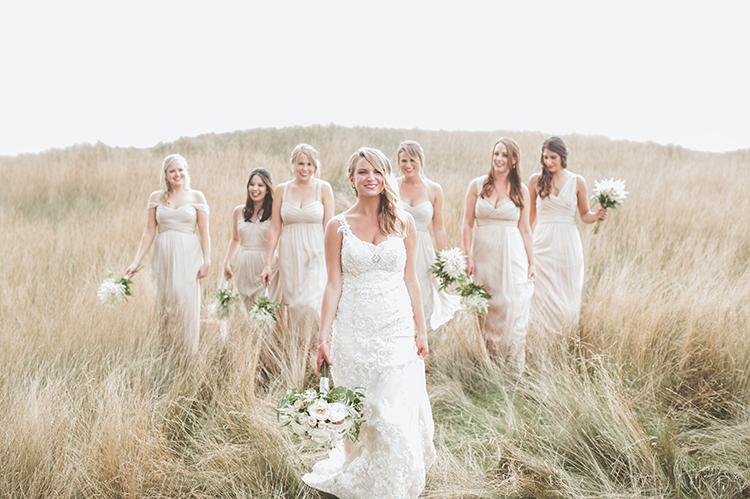 bridesmaids in white - photo by Paper Antler http://ruffledblog.com/summer-sunset-wedding-in-wisconsin