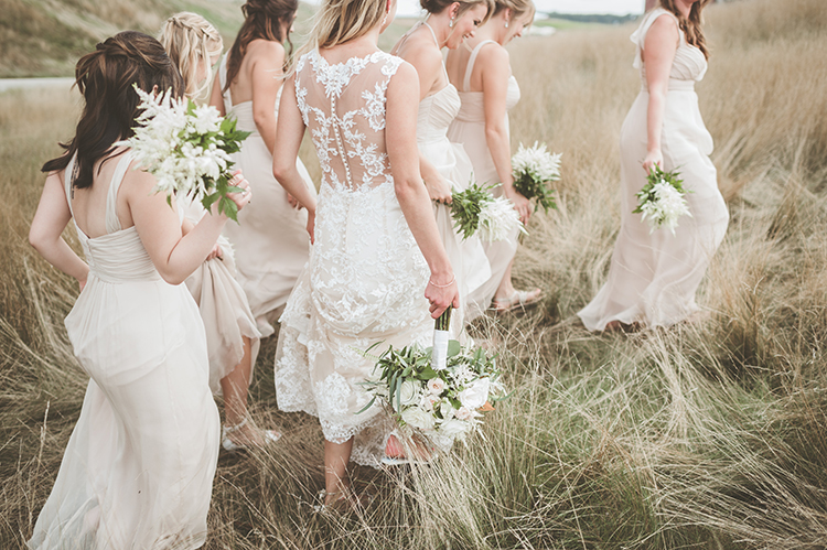 lace wedding dresses - photo by Paper Antler https://ruffledblog.com/summer-sunset-wedding-in-wisconsin