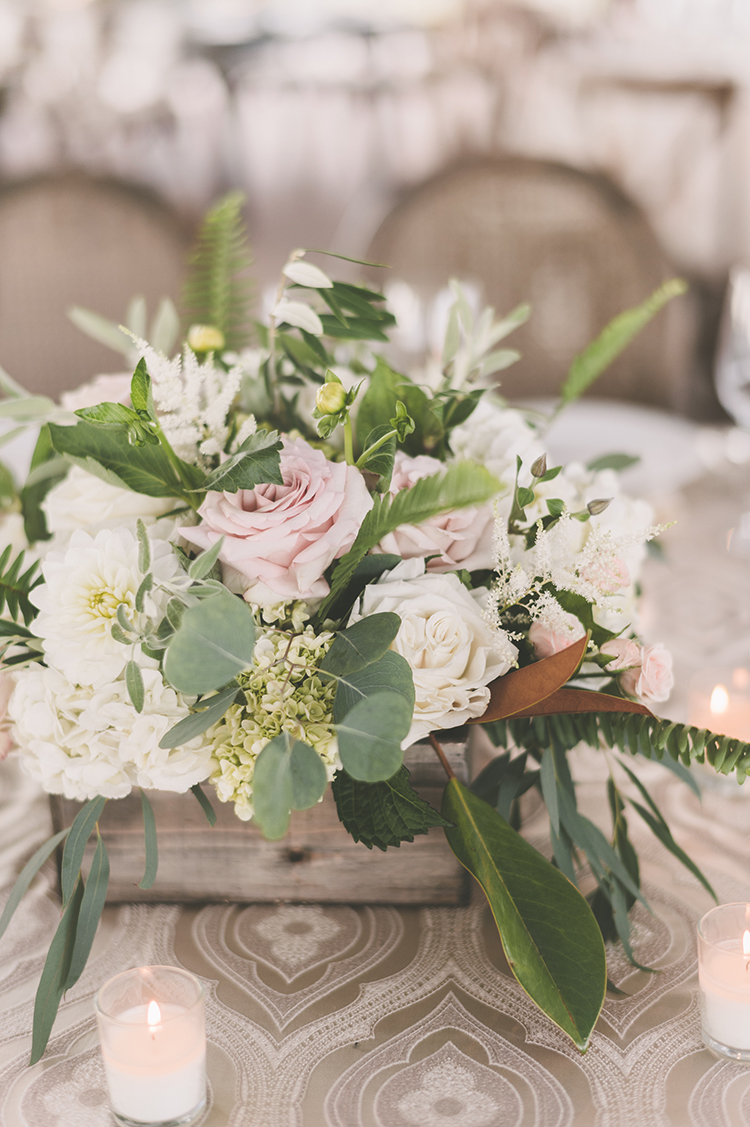 floral centerpieces - photo by Paper Antler https://ruffledblog.com/summer-sunset-wedding-in-wisconsin