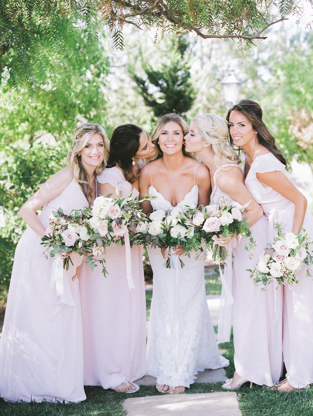 bride and bridesmaids - https://ruffledblog.com/summer-temecula-vineyard-wedding