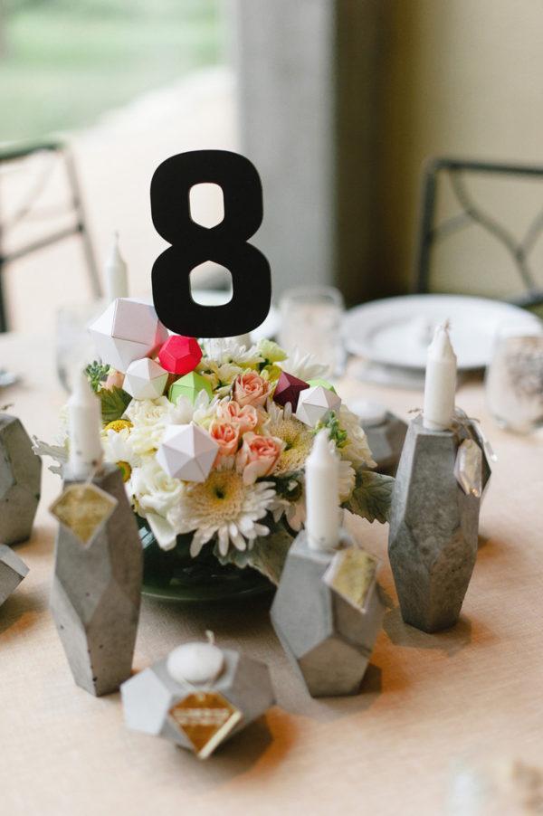 cement geometric candlesticks - photo by Sam Hugh Photography https://ruffledblog.com/40-eye-catching-geometric-wedding-ideas
