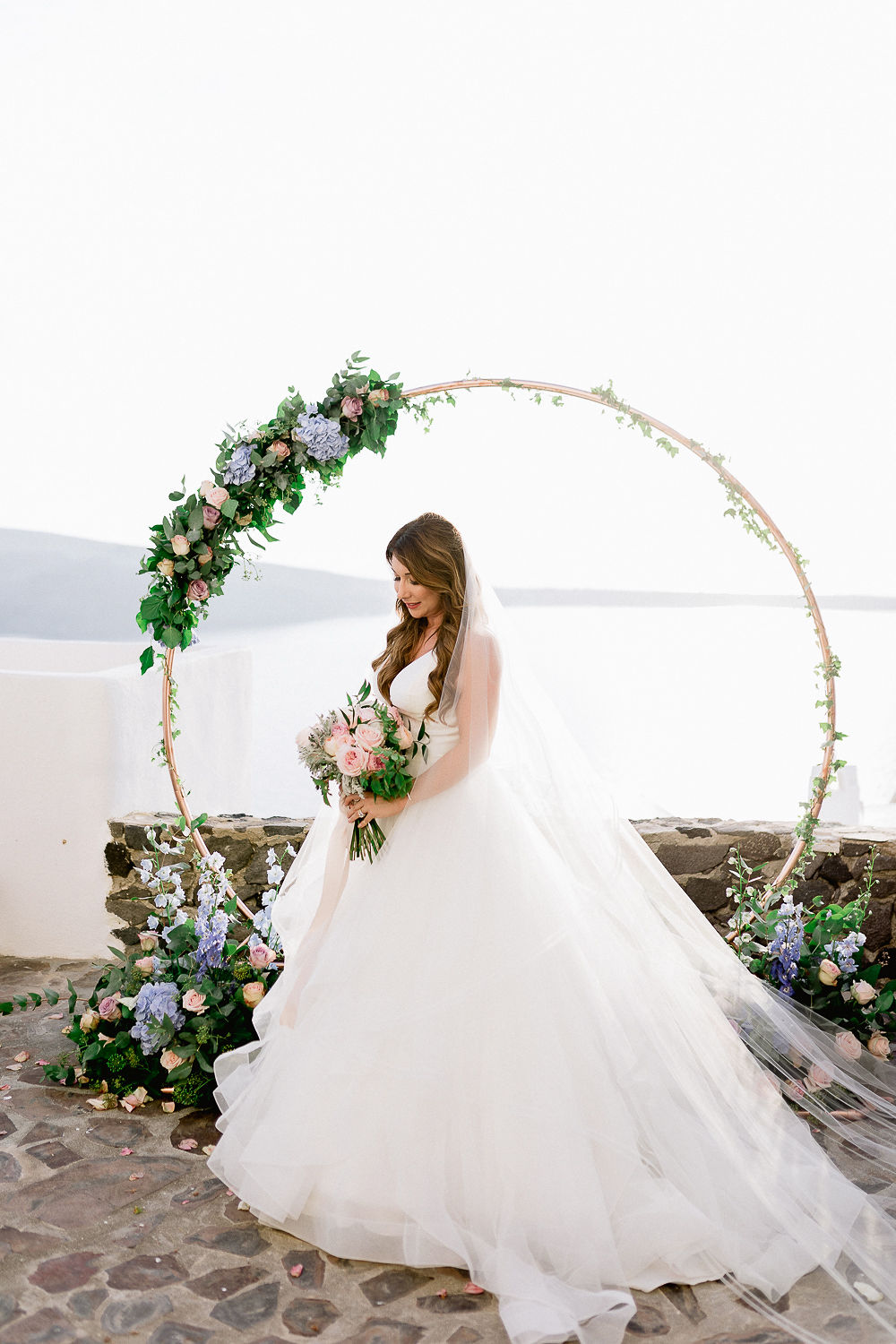ruffled wedding dress with a floral hoop backdrop