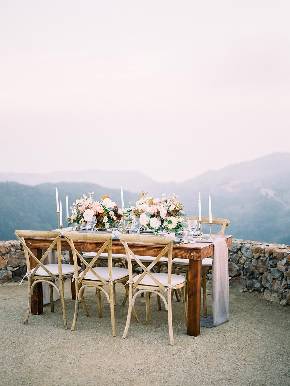 mountain wedding tablescape with silk runner and cross back chairs