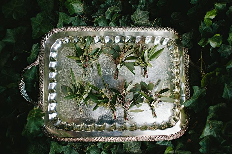 greenery boutonnieres - http://ruffledblog.com/sweet-botanical-southern-wedding-with-metallic-accents
