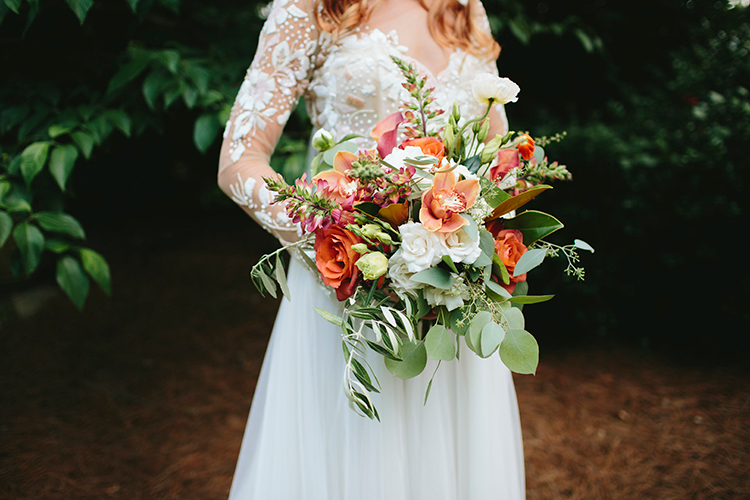orange bouquets with greenery - https://ruffledblog.com/sweet-botanical-southern-wedding-with-metallic-accents