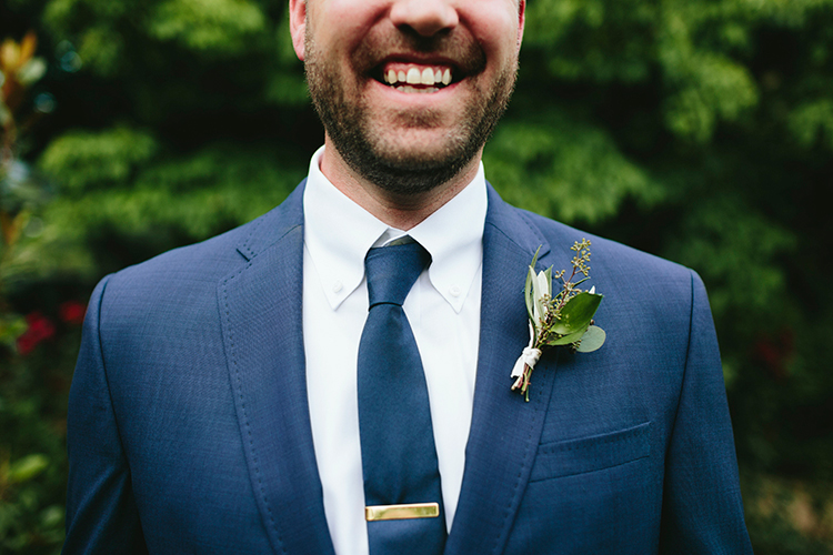 blue groom suits - http://ruffledblog.com/sweet-botanical-southern-wedding-with-metallic-accents