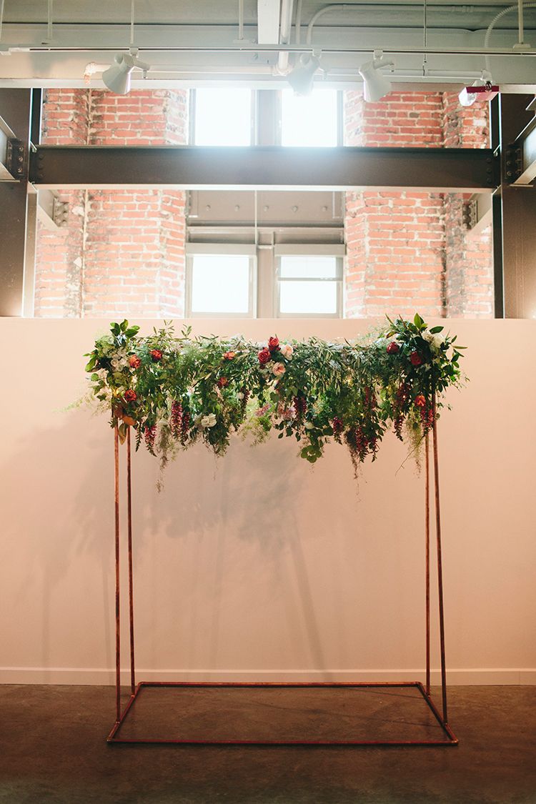 modern copper wedding ceremony arches - https://ruffledblog.com/sweet-botanical-southern-wedding-with-metallic-accents