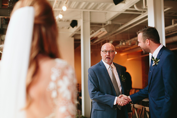dads reaction to the bride - https://ruffledblog.com/sweet-botanical-southern-wedding-with-metallic-accents