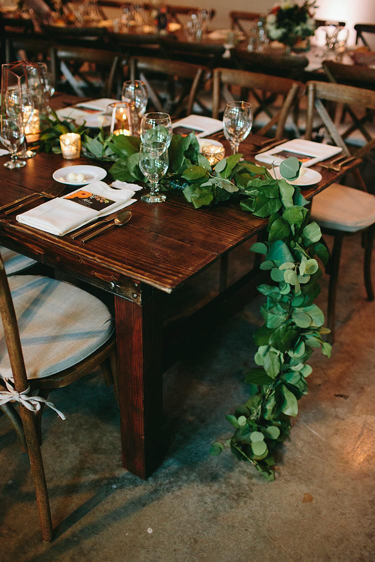 greenery table runners - http://ruffledblog.com/sweet-botanical-southern-wedding-with-metallic-accents