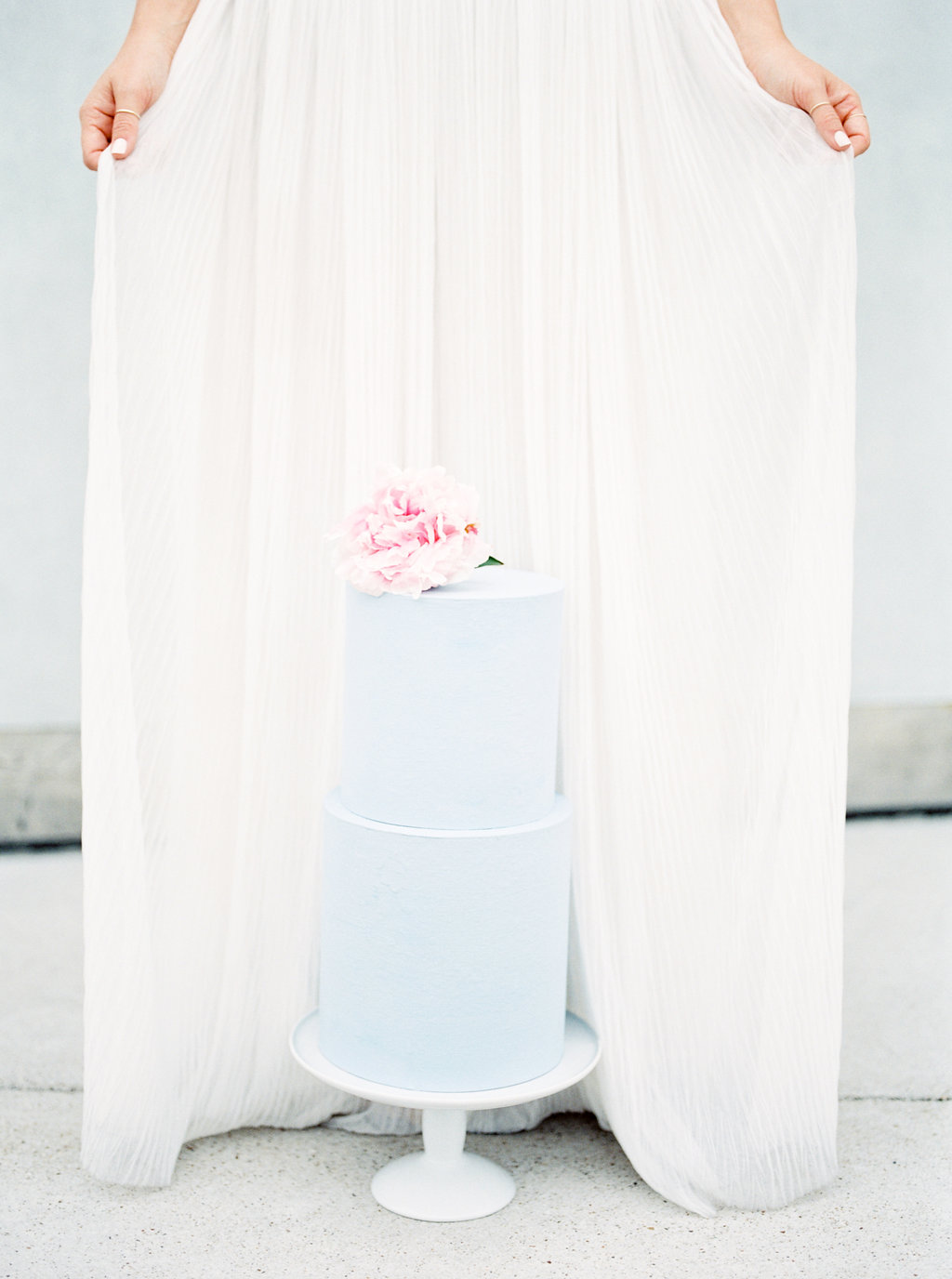 blue wedding cakes - photo by Awake Photography https://ruffledblog.com/sweet-peony-bridal-inspiration